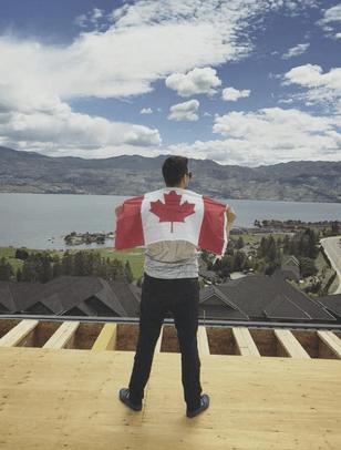 jon mac with a canadian flag